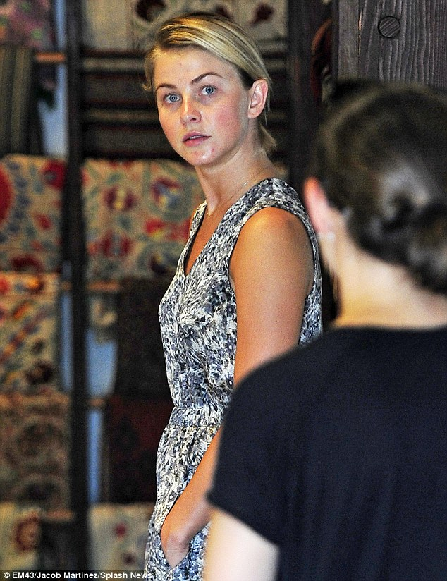 Make-up free: Julianne was fresh faced for her shopping trip which saw her checking out a carpet store with her mate