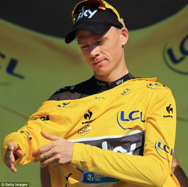 Race leader: Chris Froome with the yellow jersey