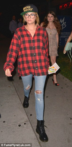 'Pretty Little Liars' actress Ashley Benson out for dinner with friends at BOA Steakhouse in Hollywood. Ashley channeled 90's grunge in a red flannel shirt and chunky black boots.