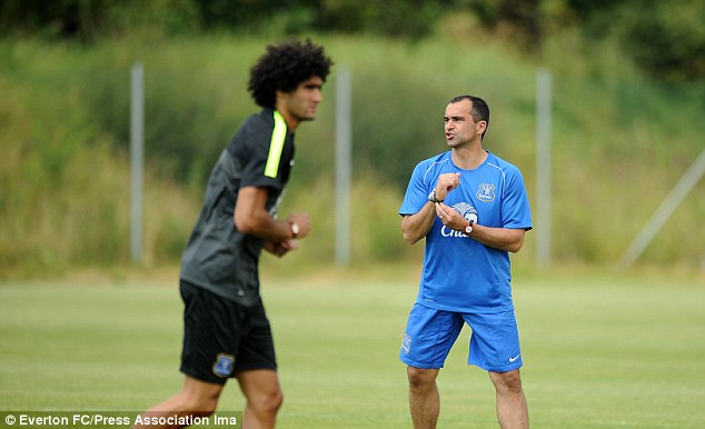 New challenge: Martinez and Marouane Fellaini training for Everton in Austria before the bike ride