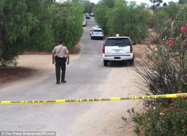 The search continues: Crime scene investigators were looking at a property in Menifee, southern California