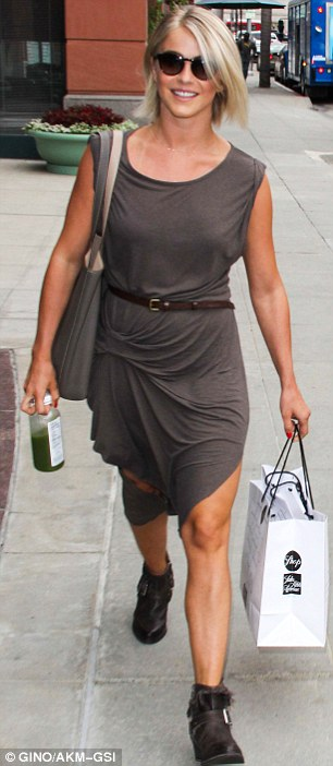Eating well: Julianne clutches a bottle of healthy green juice and a shopping bag as she ran errands