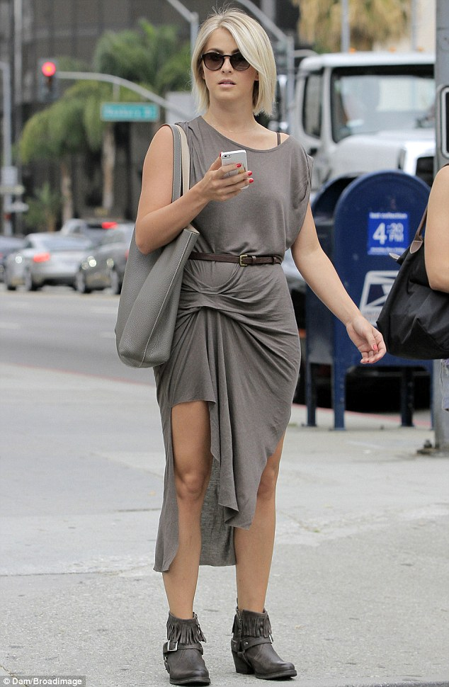 Under wraps: Julianne Hough flashes her leg through a baggy wrap dress as she steps out in Beverly Hills on Wednesday