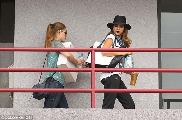 Partners in crime: Jessica was seen entering a building with her sister-in-law, who had her hands full with a large cardboard box