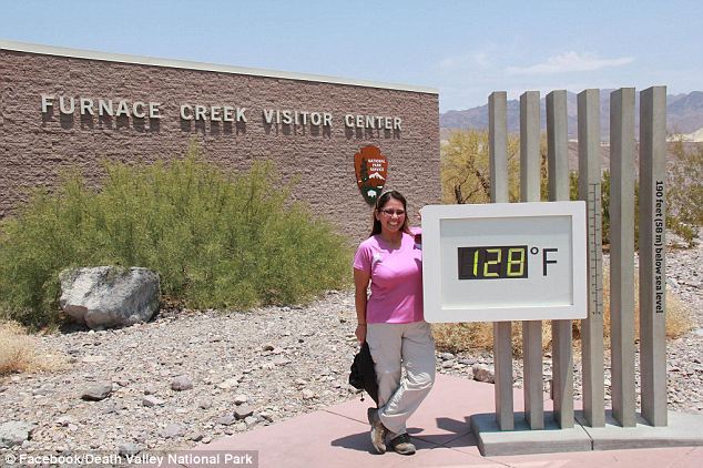 Cause for celebration? A woman beams as 128 degree heat pummels the National Park