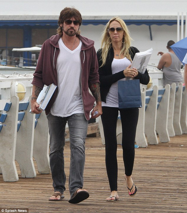 What divorce? Billy Ray Cyrus and wife Tish enjoyed a shop and stroll on Malibu pier on Wednesday