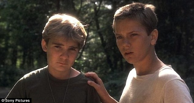 Sweeter days: Corey (R) found fame as a child actor in such iconic films as Stand By Me and The Goonies, pictured with River Phoenix in the former