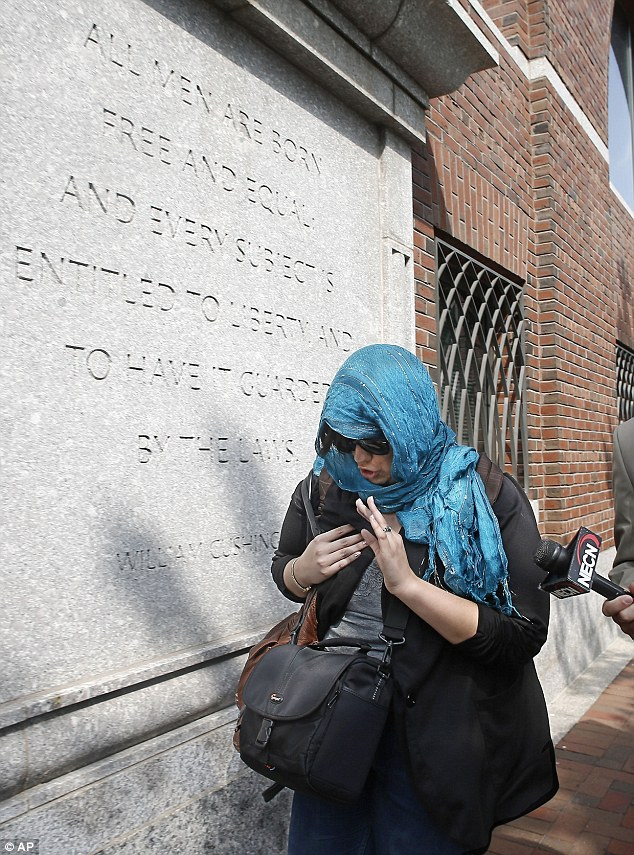 A supporter of Boston Marathon bombing suspect Dzhokhar Tsarnaev leaves federal court after his arraignment Wednesday, on July 10th, 2013, in Boston