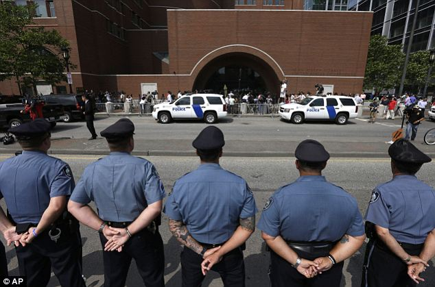 MIT Police officers form a firm line in front of the courthouse prior to the proceedings. MIT Police Chief John DiFava: 'I didn't see a lot of remorse. I didn't see a lot of regret'
