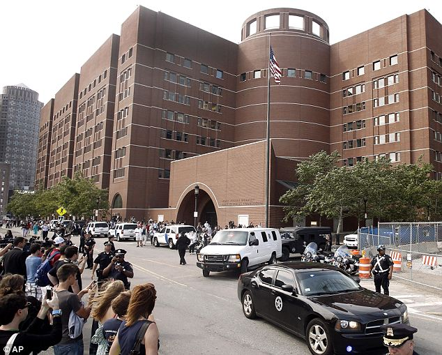 Hectic: Throngs of people gathered around the courthouse as Tsarnaev pulled up in a white van (pictured)