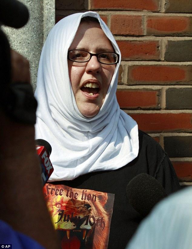 Defiant: Mary Churbuck, a supporter of  Boston Marathon bombing suspect Dzhokhar Tsarnaev, speaks to reporters outside federal court after Tsarnaev's arraignment Wednesday, on July 10th, 2013 in Boston