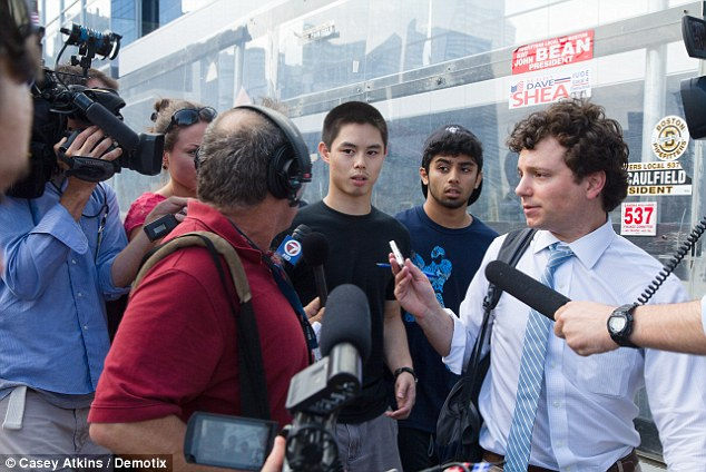 Boston, United States. 10th July 2013 -- Media question Shun (Center, last name not given), a former wrestling teammate of Dzhokhar Tsarnaev outside the U.S. District Court in Boston on Wednesday