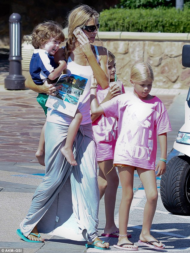 Super mother: Denise Richards looks after Charlie Sheen's son Max and their two daughters Lola and Sam while out in Malibu on Tuesday