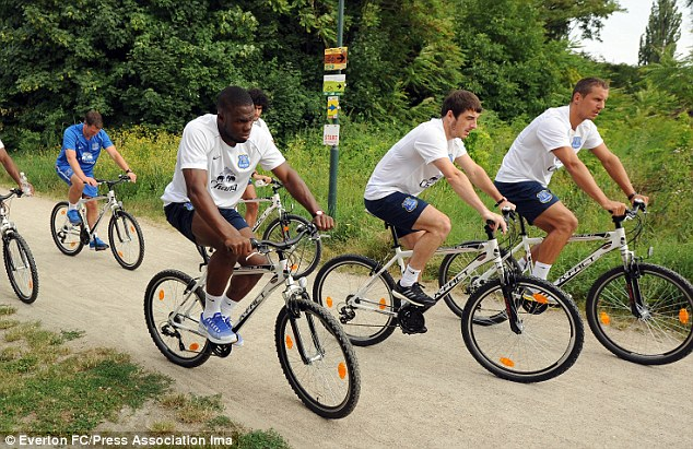 On his bike? Baines (centre) has been the centre of a bid from United, who will return with a £15m offer