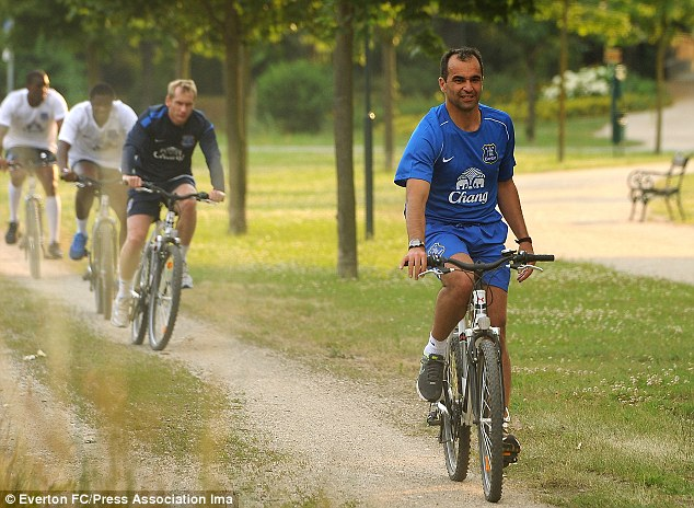 Leading by example: Everton manager Roberto Martinez leads his players on a bike ride during training