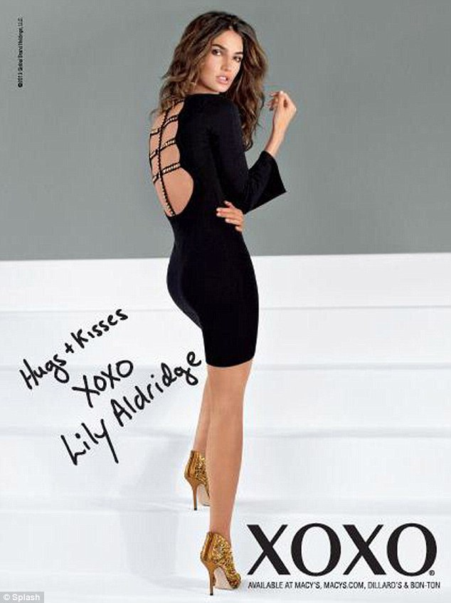 Flirty: Lily Aldridge is the new face of XOXO fashion brand's Hugs & Kisses campaign