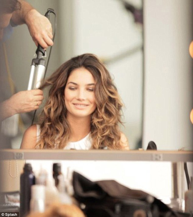 Candid camera: Lily was the picture of radiant beauty as a hairstylist took to working with her ombre tresses