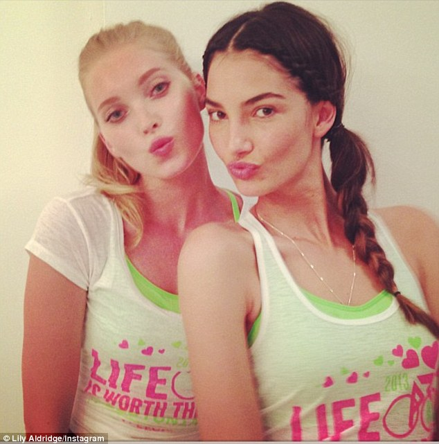 Glamour girls: Lily and fellow supermodel Elsa Hosk posed for a snap as they headed to a SoulCycle class, on Wednesday