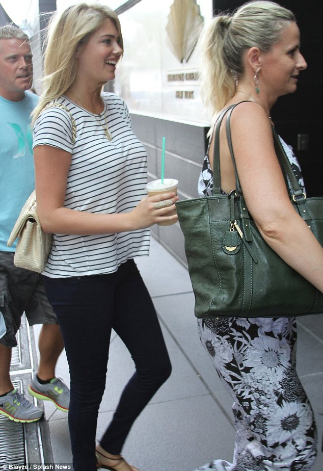 Keeping her curves covered: The Sports Illustrated model sported a baggy black and white striped T-shirt