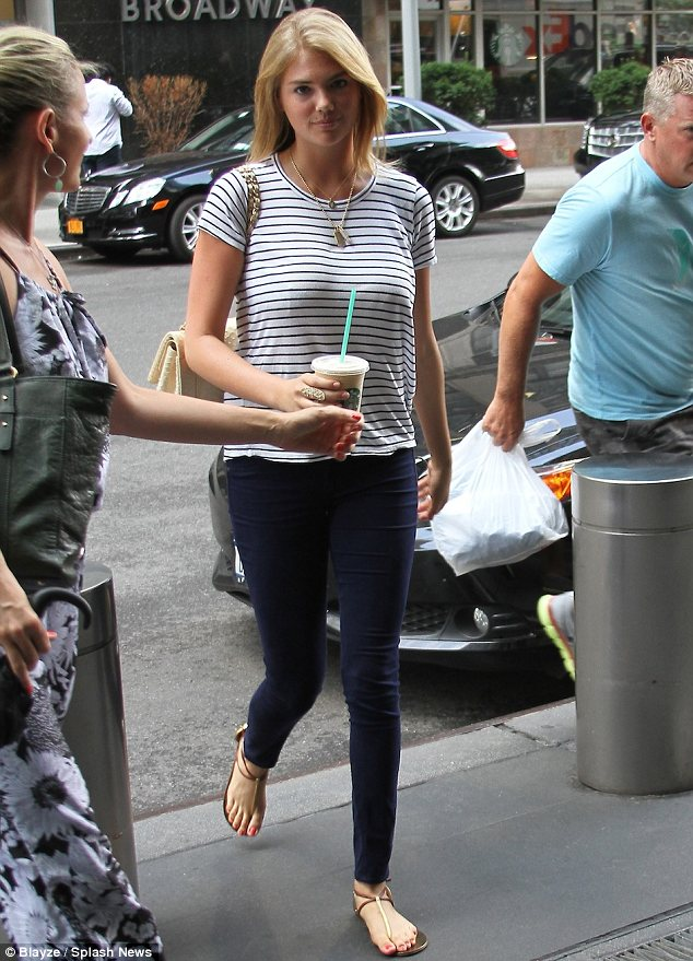 Beating the heat: Kate Upton picked up an ice cold beverage from Starbucks in New York on Wednesday
