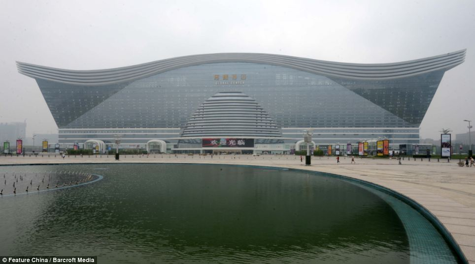 Grand: An exterior view of the New Century Global Center which has a man-made lake in the front