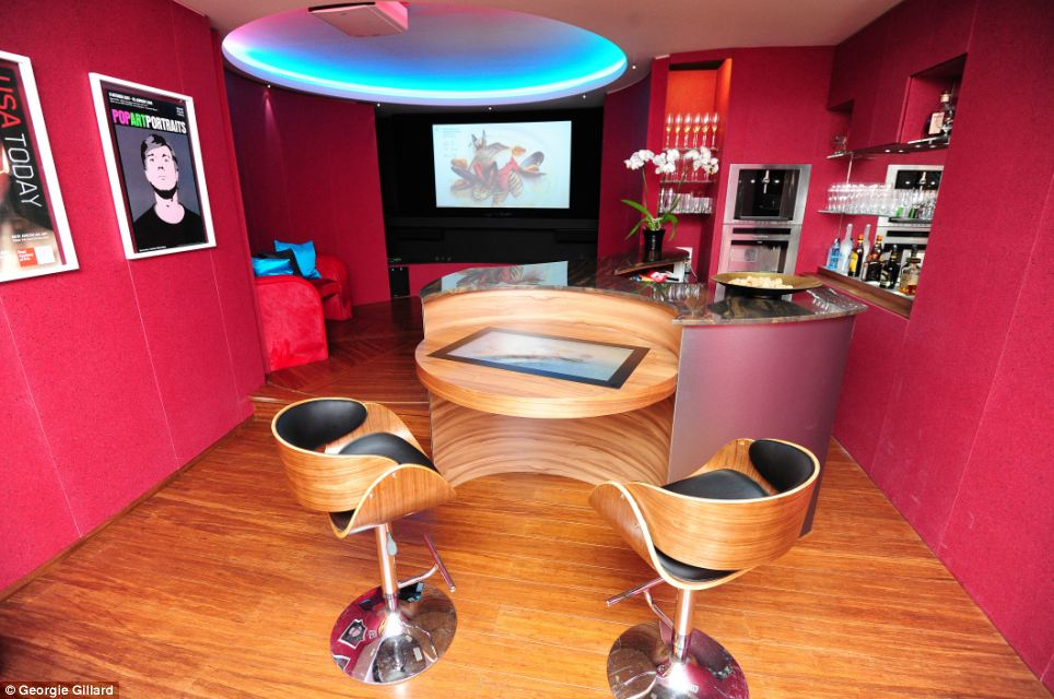 The Thunderbirds-style bar in the Cornflake house, pictured, converts into a lounge at touch of a button with the floor and wall rotating to reveal a hidden TV.