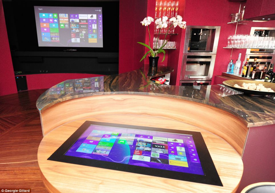 The Cornflake bar room also has a 'flat frog' screen, shown in the foreground, which is a very high-end multitouch table that four or five people, such as a whole family, can use at the same time.