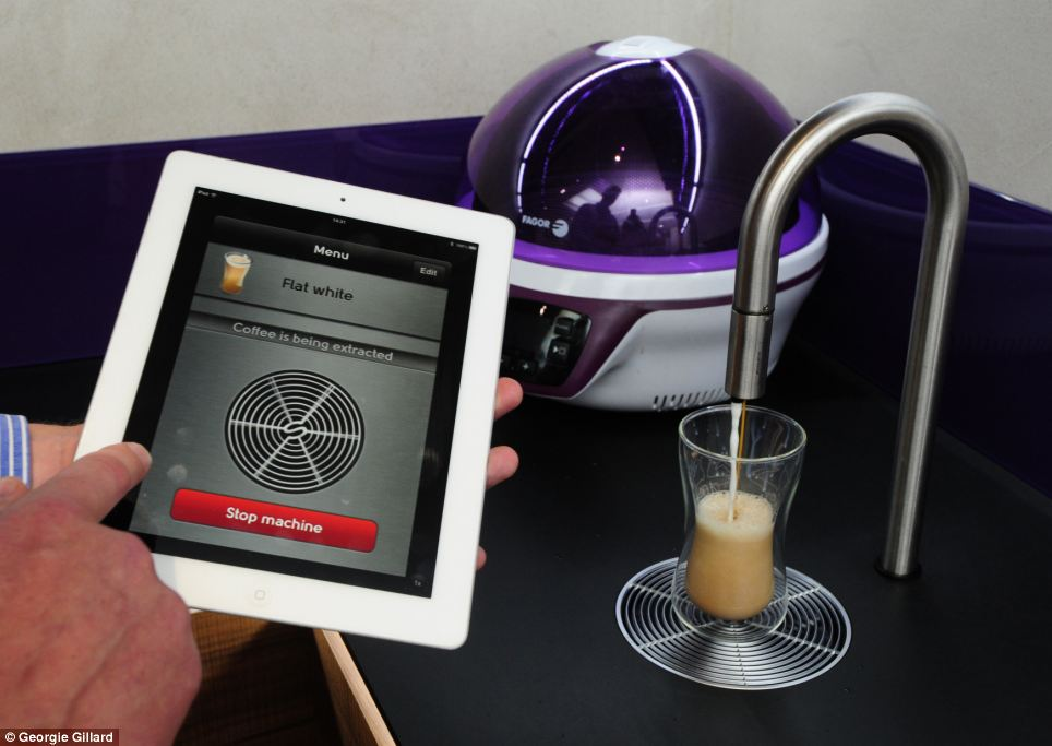 A £10,000 tap that is controlled by an iPad makes lattes at a touch of a button.