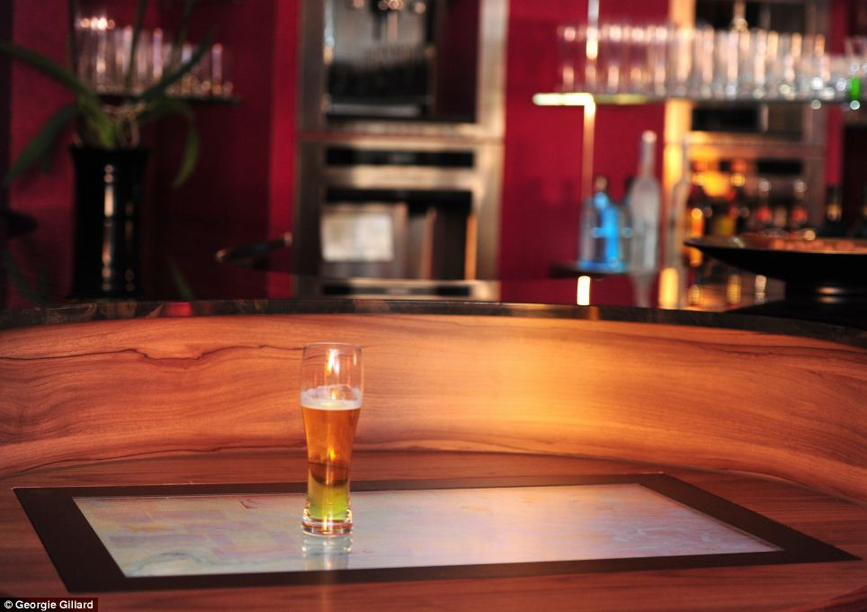 When the flat frog screen isn't being used as a touchscreen device or beaming images, it can be used with specially-created beer glasses, pictured, that have chips built into the bottom.