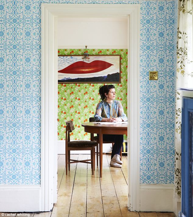The dining room with vintage wallpaper
