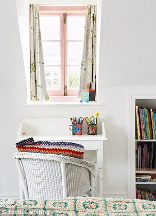 Mae's bedroom: A Victorian washstand is used as a desk. Sarah bought the vintage crocheted blanket on Ebay