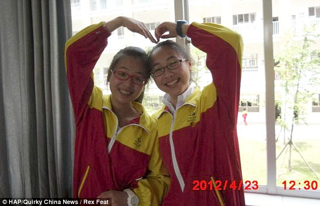 Larking about: Ye Mingyuan and Yuan Linjia, both 16, died when the Boeing 777 passenger jet slammed into a seawall while attempting to land at the end of the runway last Saturday