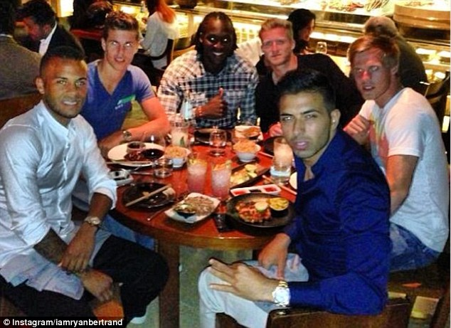 Blue Day: Ryan Bertrand, Marco van Ginkel, Romelu Lukaku, Andre Schurrle and Tamas Kalas (left-right) - as well as a friend (front) - got to know each other as they went out for a meal before Chelsea jet off on tour