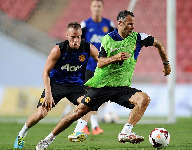 On the ball: Ryan Giggs takes part in training session