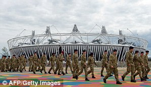 Members of the Armed Forces are shown around the site of the London 2012 Olympics in east London
