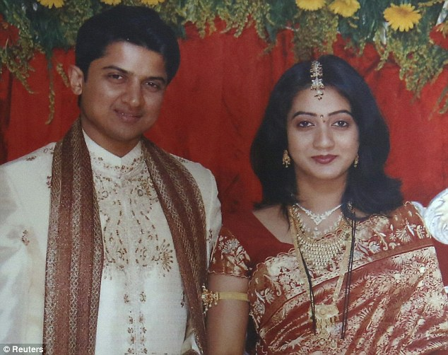 Her husband Praveen Halappanavar (seen together on their wedding day)
