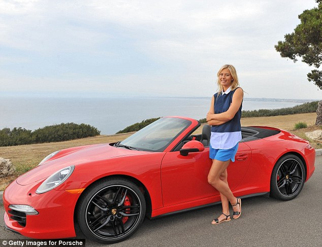 Quite the view: Maria showed off her 6ft2 frame as she stood by the small sports car