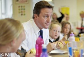 Prime Minister David Cameron listens to school children during lunch with the pupils at Newquay Junior school in 2010