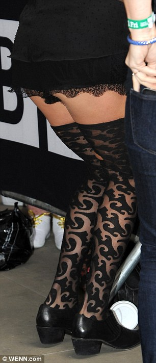 From the back: Ke$ha's flashed the paps a rear view of her risque outfit
