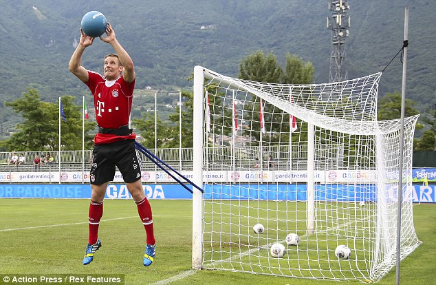 Eyes on the ball: Goalkeeper Manuel Neuer reaches for the ball during a training exercise in Arco