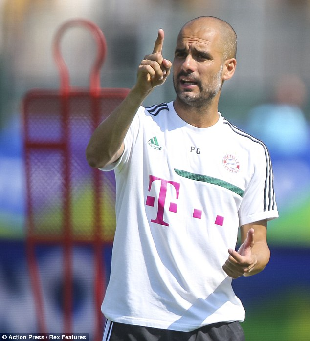 Making a point: Bayern Munich coach Pep Guardiola has hit back at Sandro Rosell over the Barcelona president's claims he didn't visit Tito Vilanova during his cancer treatment in New York