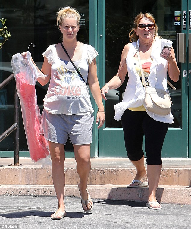 Baby bump: Glee star Heather Morris shows of her growing pregnancy belly ass she shops for a bridesmaid dress in California