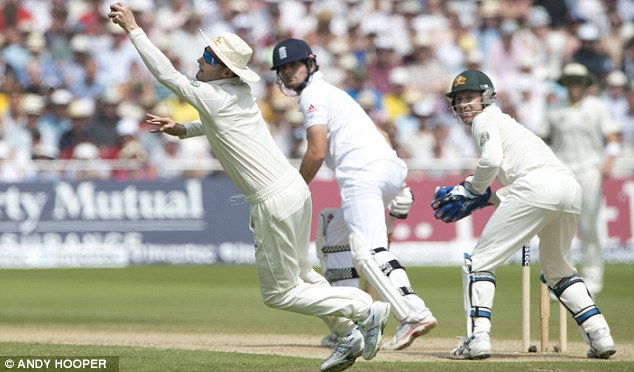 Snaffled: Michael Clarke (left) catches Cook (centre) off the bowling of Ashton Agar