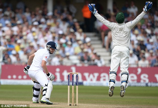 Jumping for joy: Brad Haddin (right) celebrates the dismissal of Jonny Bairstow (below)