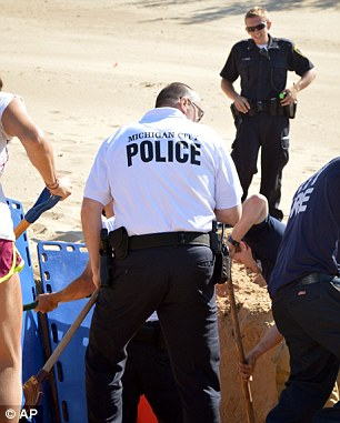 'Miracle': It took crews using heavy excavating equipment more than three hours to pull the boy out from under 11 feet of sand