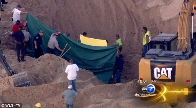Lucky to be alive: Rescuers were able to find the boy in an air pocket and pull him to safety