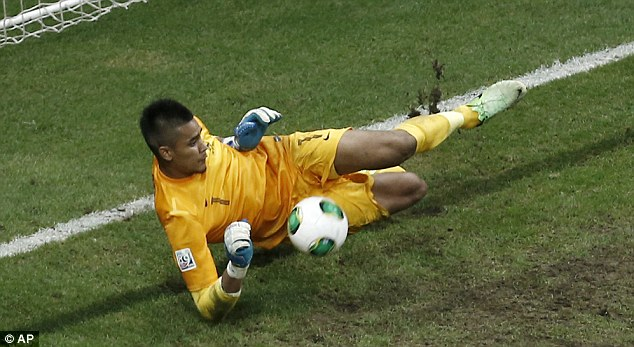 Crucial: France goalkeeper Alphonse Areola saves a penalty from Uruguay's Emiliano Velzquez