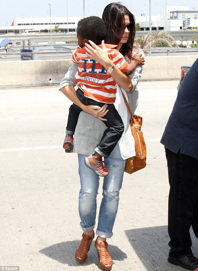 Pride and joy: Sandra Bullock arrived at LAX with her son Louis Bardo Bullock on Friday