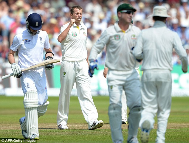 Getting through: Peter Siddle (2nd L) celebrates after taking the wicket of England's Graeme Swann
