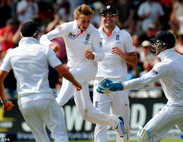Jumping for joy: England's Joe Root celebrates after Bowling Ed Cowan